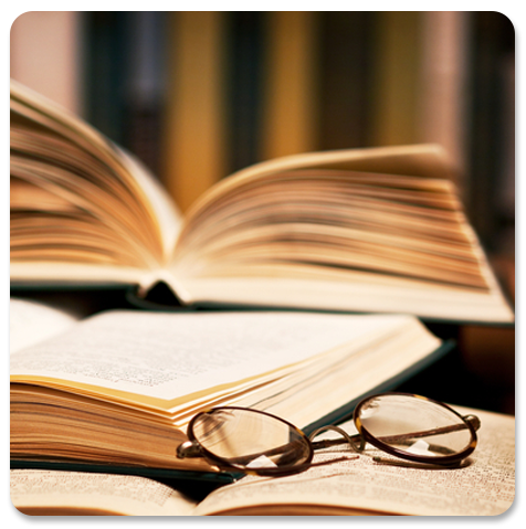 Stack of Books and Reading Glasses Image