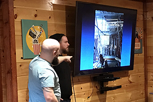 Three members of east coast install team giving presentation in cabin