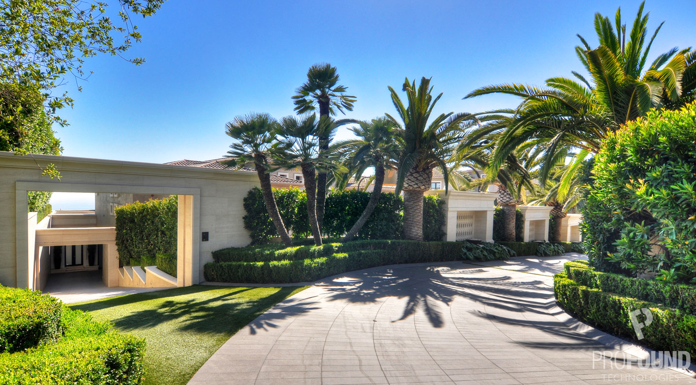 Curving Driveway of California Based Residence with Palm Trees